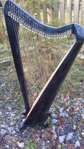 Custom Callan 34 string lever harp in coloured rippled sycamore