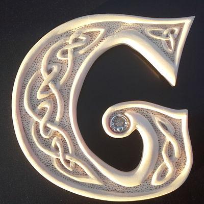 Hand carved Celtic G